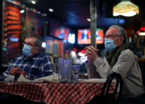 <strong>Michael Rowland (right) and Harry Freeman talk with friends during lunch at Rendezvous Dec. 1, 2020.</strong> (Patrick Lantrip/Daily Memphian file)