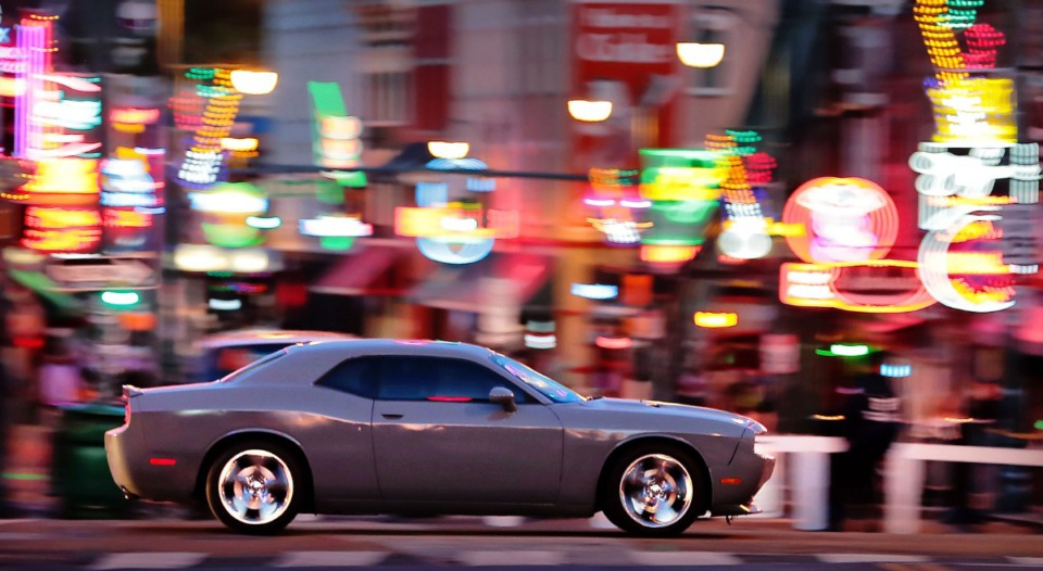 <strong>Muscle cars (in a file photo) pass by the lights on Beale Street while cruising B.B. King Boulevard in Downtown Memphis. Law enforcement and lawmakers are hoping a new state law that goes into effect July 1, which will increase the penalty for illegal drag racing statewide, helps with the problem.</strong> (Jim Weber/Daily Memphian)