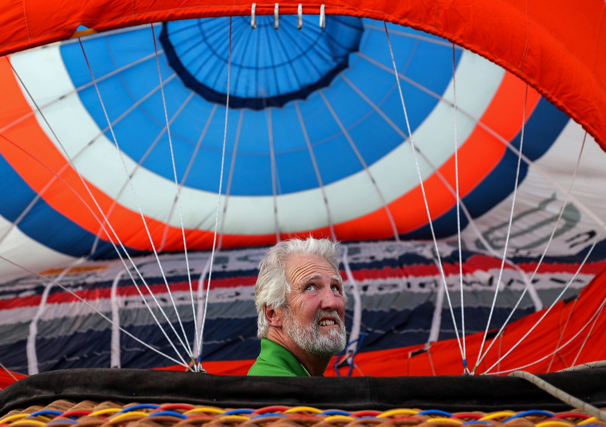 <strong>Keith Erwin checks the wind while filling up his hot air balloon during the first day of the Bluff City Balloon Jamboree in Collierville on June 18, 2021.</strong> (Patrick Lantrip/Daily Memphian)