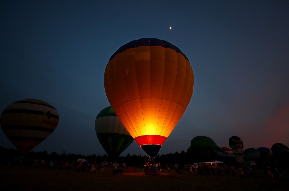 <strong>Hot air balloons light up the sky during the first day of the Bluff City Balloon Jamboree in Collierville on June 18, 2021.</strong> (Patrick Lantrip/Daily Memphian)