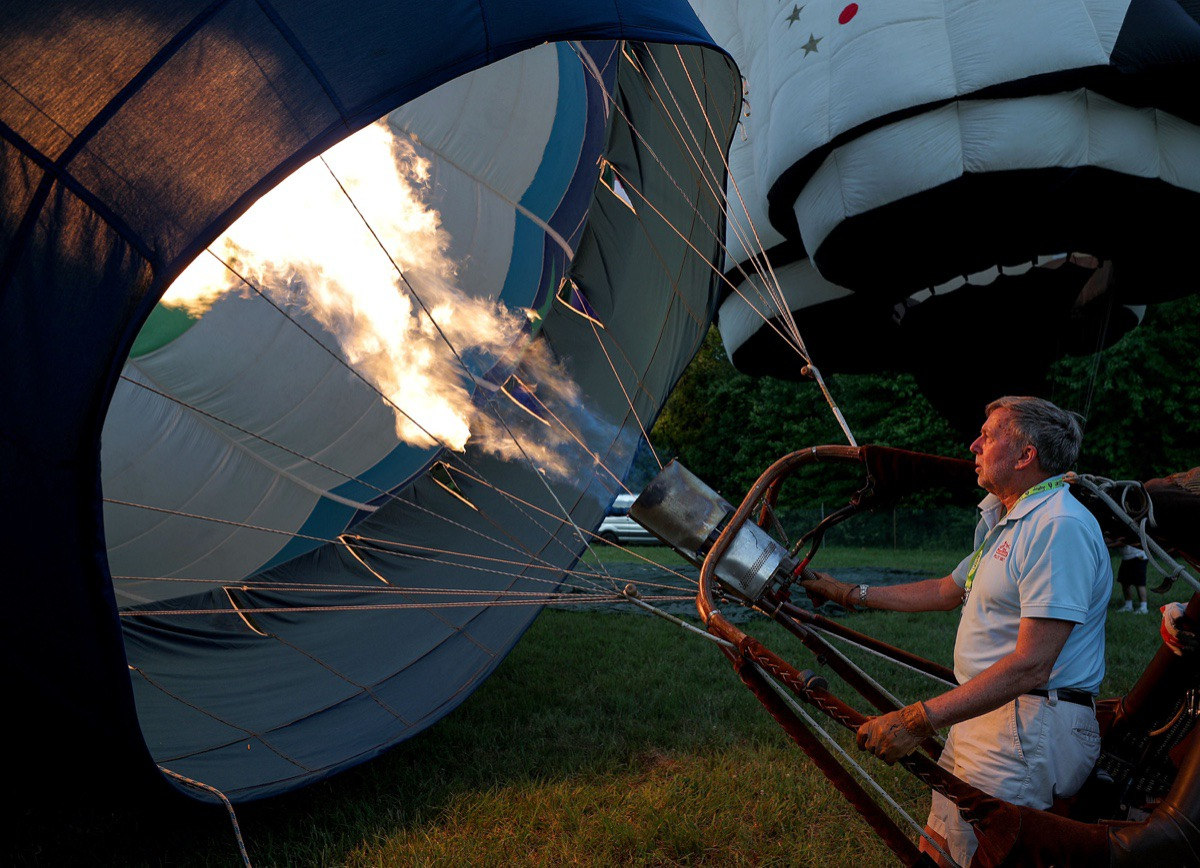 <strong>Gary Whitby gets his hot air balloon ready during the first day of the Bluff City Balloon Jamboree in Collierville on June 18, 2021.</strong> (Patrick Lantrip/Daily Memphian)