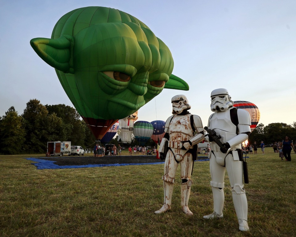 <strong>A hot air balloon shaped like Yoda keeps an eye on a pair of Stormtroopers during the first day of the Bluff City Balloon Jamboree in Collierville on June 18, 2021.</strong> (Patrick Lantrip/Daily Memphian)
