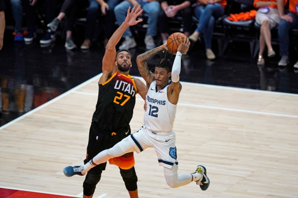 <strong>Utah Jazz center Rudy Gobert (27) guards Memphis Grizzlies guard Ja Morant (12) during the second half of Game 5 of an NBA basketball first-round playoff series Wednesday, June 2, 2021, in Salt Lake City.</strong> (AP Photo/Rick Bowmer)