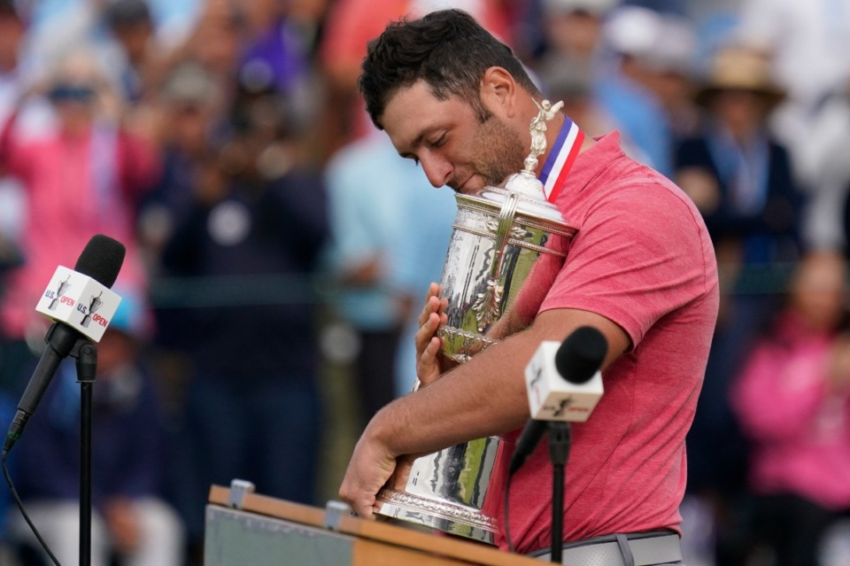 <strong>Jon Rahm of Spain holds the trophy after the final round of the U.S. Open Golf Championship on Sunday, June 20, at Torrey Pines Golf Course in San Diego.</strong>&nbsp;<strong>Rahm has committed to play at the WGC-FedEx St. Jude Invitational at TPC-Southwind.</strong> (Gregory Bull/AP)