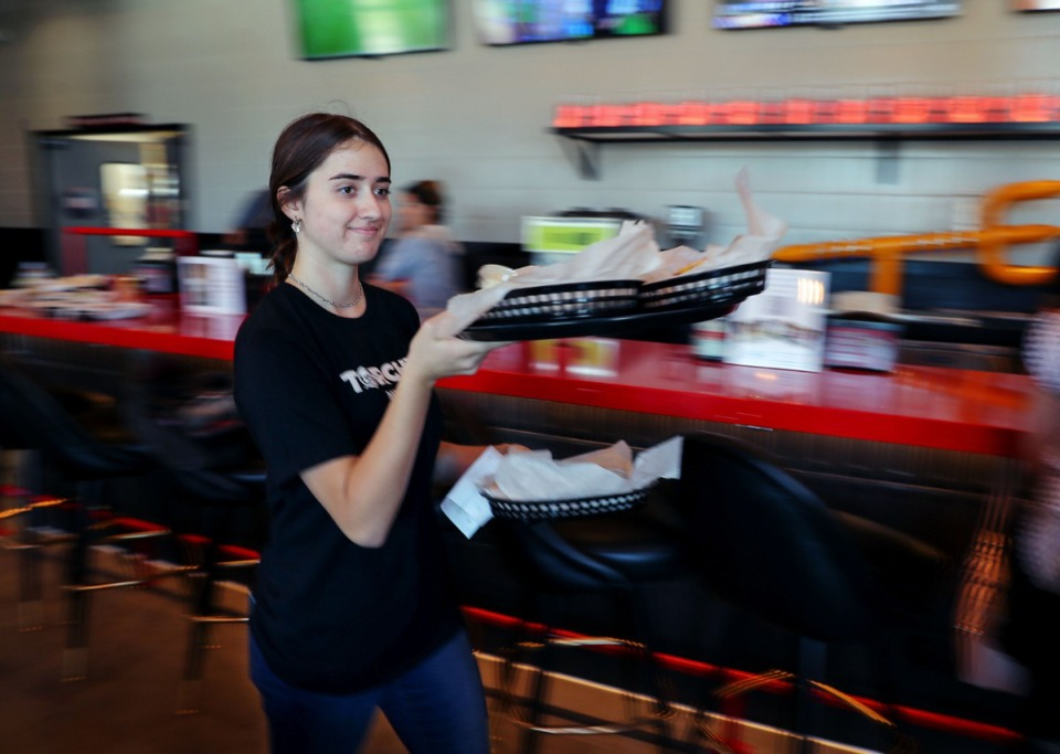 <strong>Merrick Miller carries out an order of tacos at Torchy's Tacos on June 23, 2021.</strong> (Patrick Lantrip/Daily Memphian)