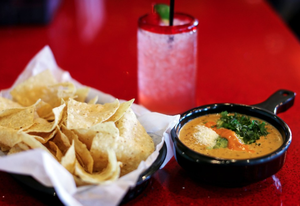 <strong>The green chili queso and chips at Torchy's Tacos are made from scratch.</strong> (Patrick Lantrip/Daily Memphian)