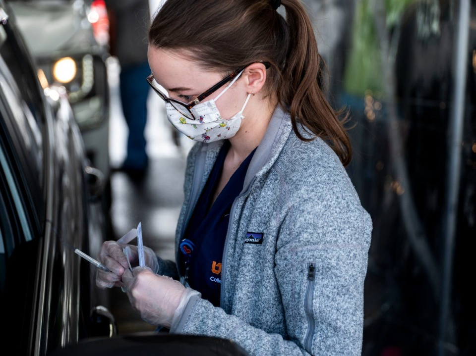 <strong>Lynley Matthews, a second-year UTHSC medical student, prepares to administer a COVID-19 vaccination on Sunday, Feb. 21, 2021 at Southwest Tennessee Community College - Whitehaven Center.</strong> (Brad Vest/Special to the Daily Memphian)