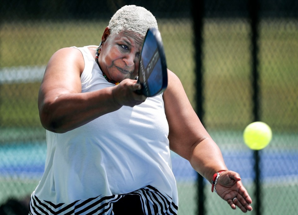 <strong>Darnella Bennett hits a return shot while playing on the new Bartlett pickleball courts on Thursday, June 24, 2021 in Shadowlawn Park.</strong> (Mark Weber/The Daily Memphian)