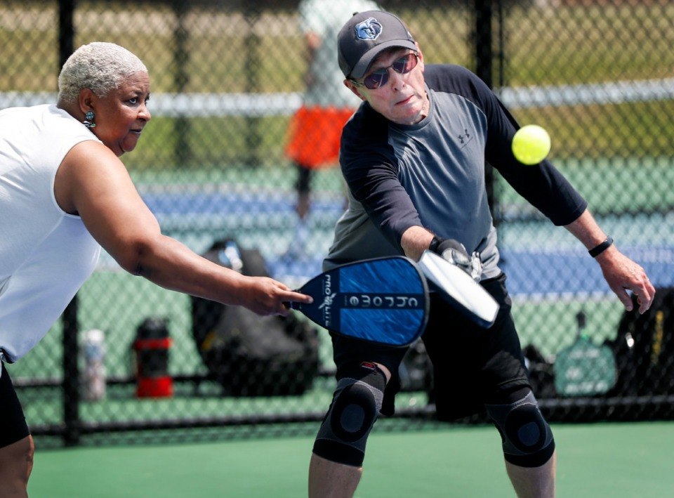 <strong>Darnella Bennett (left) and Rex Brown reach for the ball while playing on the new Bartlett pickleball courts.</strong> (Mark Weber/The Daily Memphian)