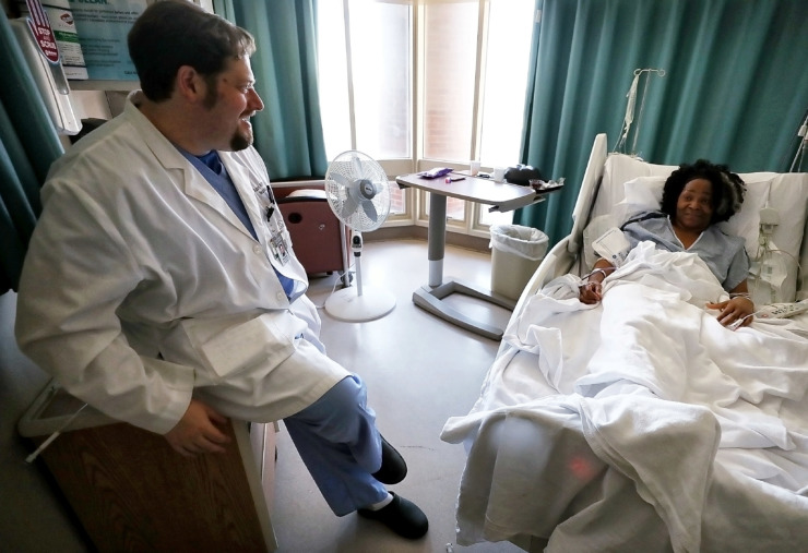 <strong>Dr. Adam Arthur talks with his patient Cornelius Brown as she recovers from a new FDA-approved procedure to treat brain aneurysms at Methodist University Hospital on Jan. 29, 2019.</strong> (Jim Weber/Daily Memphian)