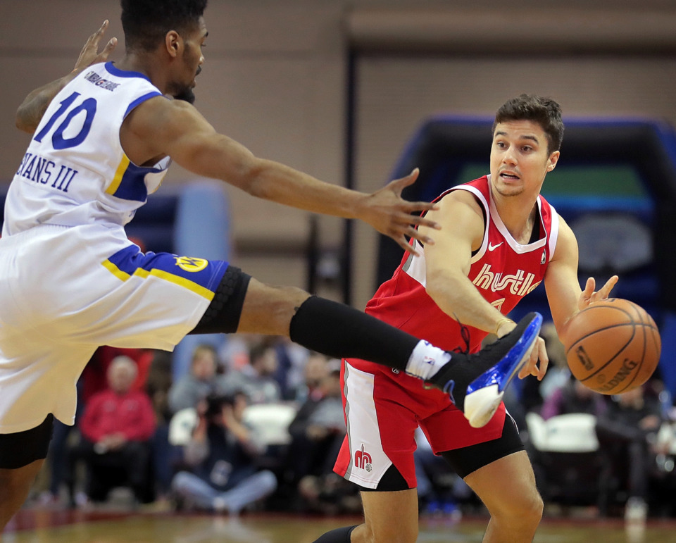 <strong>Memphis Hustle guard Dusty Hannahs tries to pass around Warriors guard Jacob Evans during a game against Santa Cruz on Wednesday, Jan. 30. Hannahs, 25, a former Arkansas guard, is the only player on the roster who played for the Hustle last season.</strong> (Jim Weber/Daily Memphian)