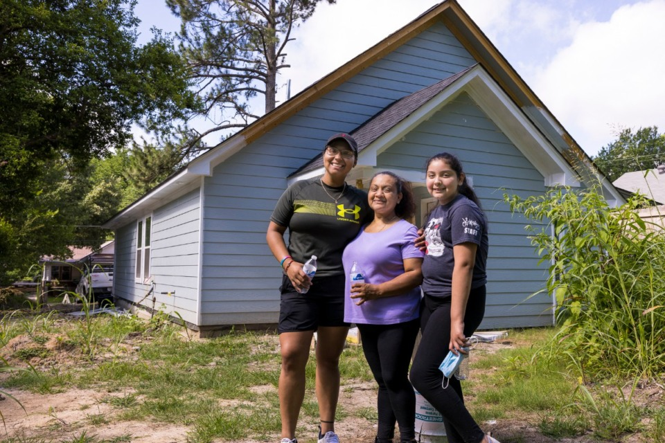 <strong>Yajarra Puentes (from left), Flor Cordova and Roselin Puentes tour the home, built by Binghampton Community Land Trust on the site of a formerly blighted house.</strong>&nbsp;(Ziggy Mack/Special to Daily Memphian)