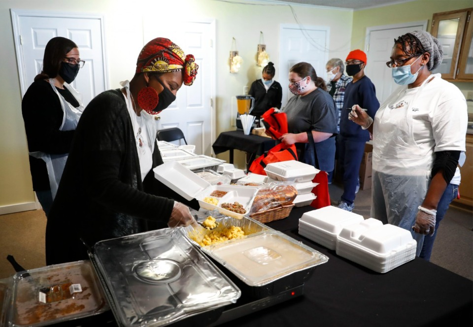 <strong>Healthy Frayser volunteers prepare boxed lunches for area residents on Friday, Nov. 13, 2020 at The Neighborhood Cafe.</strong> (Mark Weber/The Daily Memphian file)