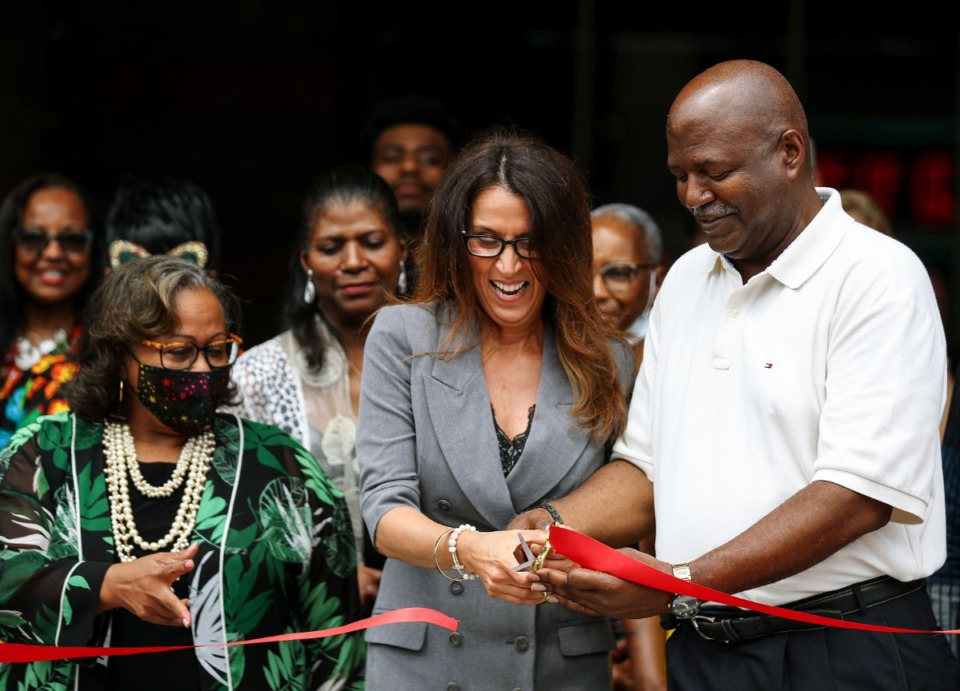 <strong>Marie Pizano cuts the ribbon on the first phase of MVP3 Studios' entertainment complex at the old Malco Majestic Cinema July 1, 2021 while business partner Darnell Stitts and Memphis City Councilwoman Patrice Robinson look on.</strong> (Patrick Lantrip/Daily Memphian)