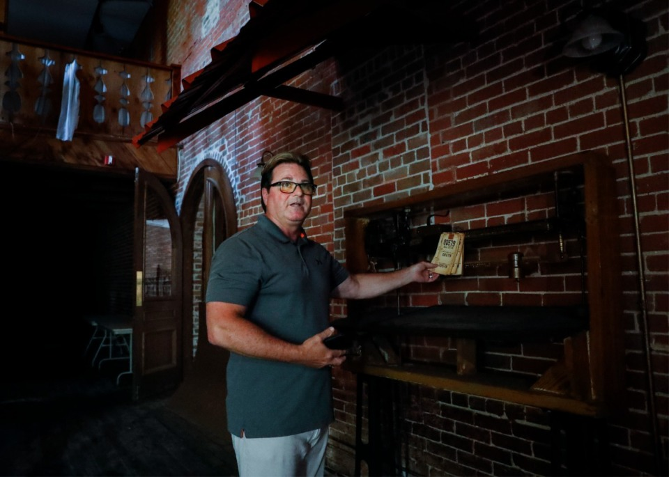 <strong>Developer Cliff McLemore points out old cotton weight tickets at the Cotton Gin in Olive Branch. McLemore will redevelop the event space into the focal point of a $7 million entertainment district.</strong> (Mark Weber/The Daily Memphian)
