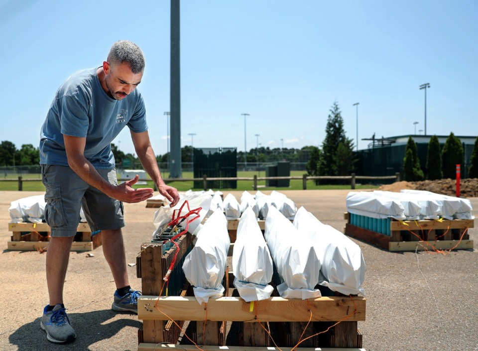 <strong>Pyrotechnician Michael O'Neil shows off the set up for the Collierville fireworks show in Cox Park July 3, 2021.</strong> (Patrick Lantrip/Daily Memphian)