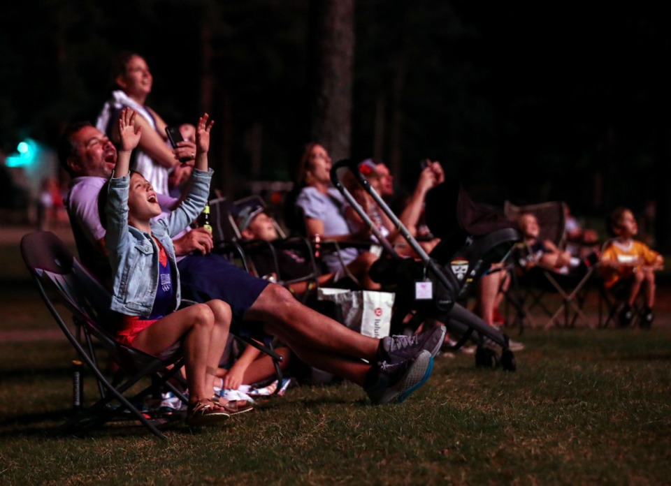 <strong>Nine-year-old Mary Paisley Bingham excitedly watches the finale of the Collierville fireworks show at H.W. Cox Park with her family July 3, 2021.</strong> (Patrick Lantrip/Daily Memphian)