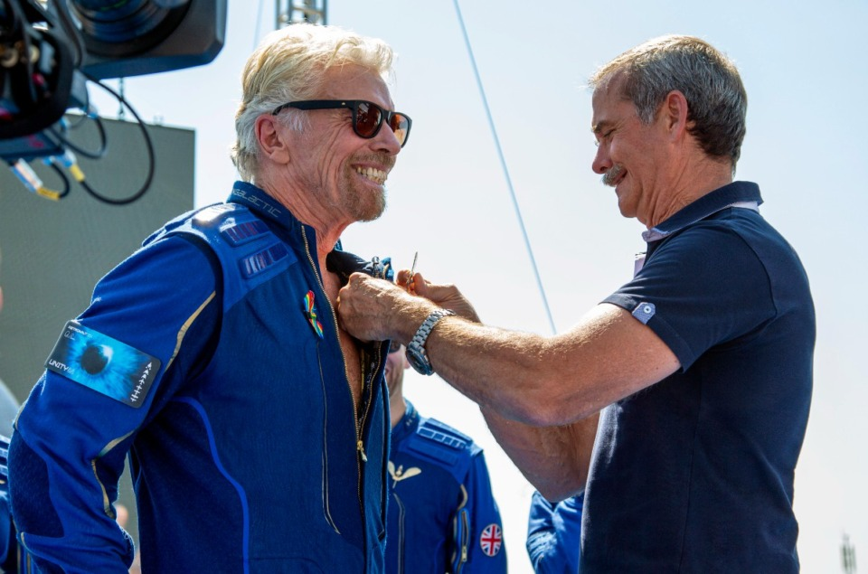 <strong>Virgin Galactic founder Richard Branson (left) receives a Virgin Galactic&nbsp; astronaut wings pin from Canadian astronaut Chris Hadfield after his flight to space from Spaceport America near Truth or Consequences, N.M., Sunday, July 11, 2021.</strong> (Andres Leighton/AP)