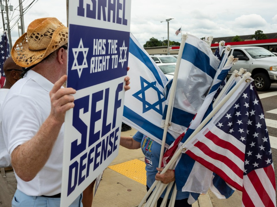<strong>Israeli and American flags are handed out during a rally Sunday, July 11, for Israel organized by Memphis Friends of Israel at the intersection of Poplar and Ridgeway.</strong> (Brad Vest/Special to The Daily Memphian)