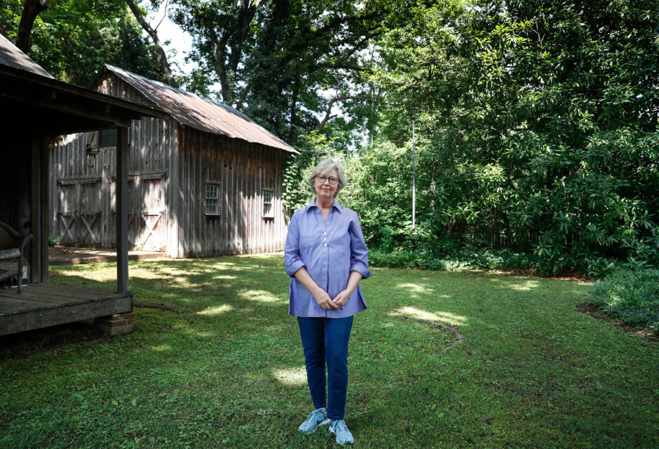 <strong>Pam Hassler stand in the backyard of her historic Collierville home on Tuesday, July 13, 2021. Hassler, opposes a proposed plan by the city to build a four level parking garage behind her home.</strong> (Mark Weber/The Daily Memphian)