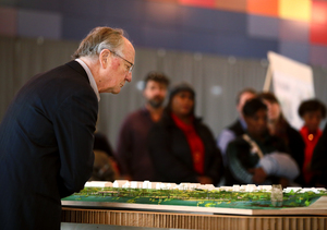 <strong>Henry Turley (left), who is a potential funder for the new design of Tom Lee Park, takes a close look at the to-scale model of the proposed park created by Studio Gang architects. The new design will expand the park to a total of six miles and will include five park districts.</strong> (Houston Cofield/Daily Memphian)