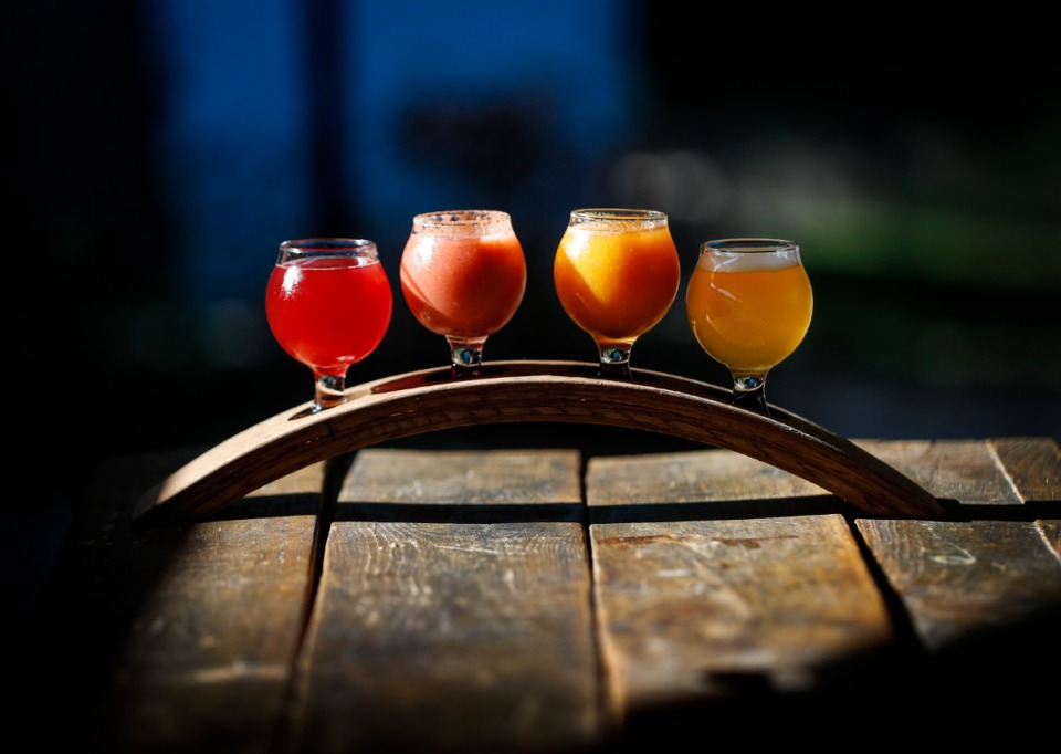 <strong>A flight of beers offers samples of the beers on tap. This one includes Quench Cherry Lime Sour, Guava Dog Days Shandy, Mango Dog Days Shandy and Traffic IPA.</strong> (Mark Weber/The Daily Memphian)