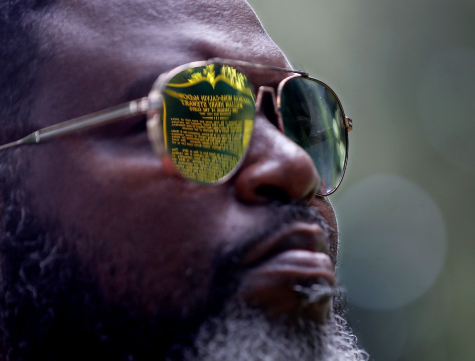 <strong>The historical marker of lynching victim Thomas Moss, who was a close friend of Ida B. Wells, is reflected on the sunglasses of Gregory Nelson as he reflects at Moss' grave at Zion Christian Cemetery July 15, 2021.</strong> (Patrick Lantrip/Daily Memphian)