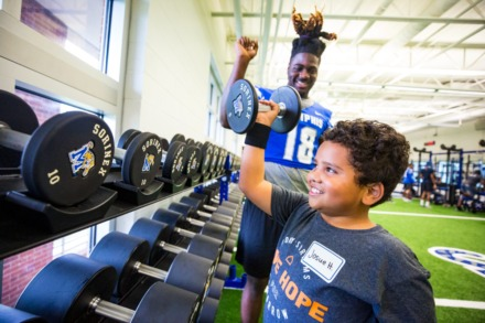 <strong>University of Memphis football team member Jawon Odums teaches Josue Hernandez weights during Hope to Dream football minicamp at University of Memphis South Campus on July 17, 2021.</strong> (Ziggy Mack/Special to The Daily Memphian)