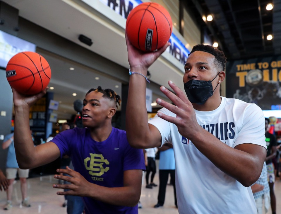 <strong>Rodney McNeal (left) faces off against Grizzlies shooting guard Desmond Bane at a back-to-school giveaway at the FedExForum July 17, 2021.</strong> (Patrick Lantrip/Daily Memphian)