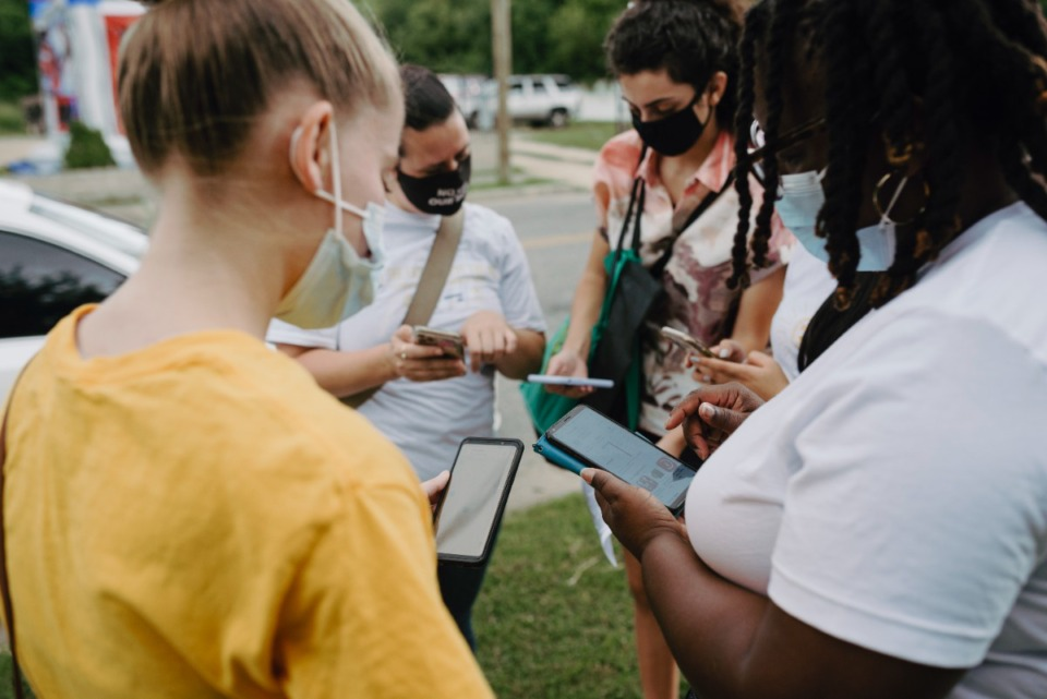 <strong>Volunteers plan their routes for the vaccine literature drop on Saturday, July 17th, 2021.</strong> (Lucy Garrett/Special to the Daily Memphian)