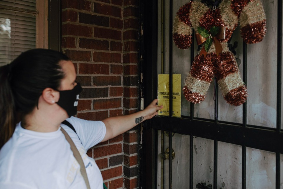 <strong>Janeita Lentz leaves a vaccine literature booklet at someone's door. Saturday, July 17th, 2021.</strong> (Lucy Garrett/Special to the Daily Memphian)