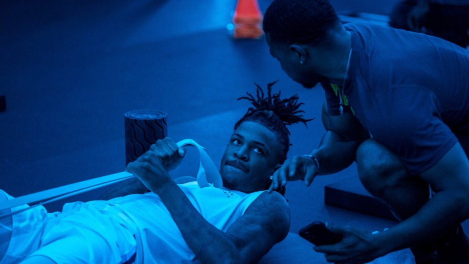 <strong>Former Memphis Tigers player and House of Athlete basketball trainer Trey Draper, right, works with Ja Morant.</strong> (Courtesy Grayson Morant)