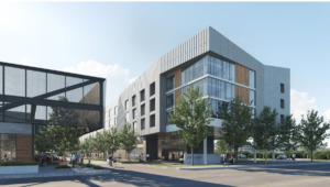 <strong>Plans for the old Memphis Police Department building on Union include a mixed-use development of a boutique hotel, condominiums and a six-bay retail strip. This rendering shows the retail building at left, with a dining patio at the front.</strong> (Credit: designshop)