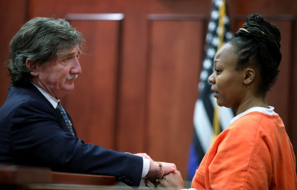 <strong>In this file photo, attorney Leslie Ballin (left) speaks with his client Latoshia Daniels. Daniels, who is accused of killing Mississippi Boulevard Christian Church Executive Pastor Brodes Perry, will get a new attorney. Ballin has represented Daniels since her 2019 arrest.&nbsp;</strong>(Houston Cofield/Daily Memphian file)