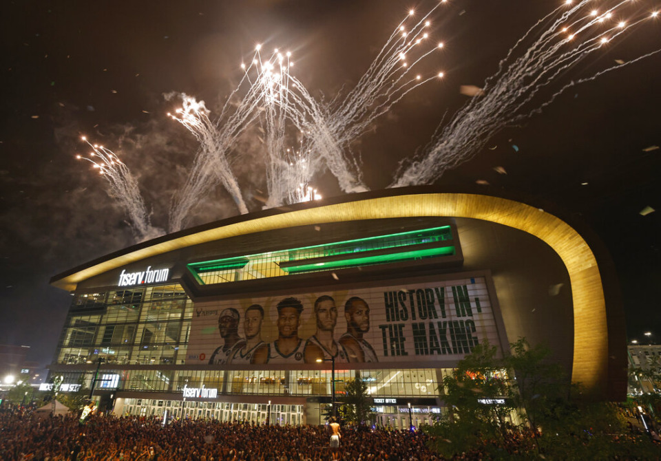 <strong>Fireworks explode over Fiserv Forum after the Milwaukee Bucks defeated the Phoenix Suns in Game 6 of the NBA basketball finals to win the NBA Championship early Tuesday, July 20, in Milwaukee.</strong> (Jeffrey Phelps/AP)