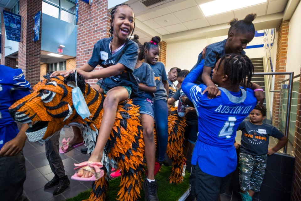 <strong>University of Memphis football team member Calvin Austin III plays with youth during Hope to Dream football minicamp at University of Memphis South Campus.</strong> (Ziggy Mack/Special to The Daily Memphian)