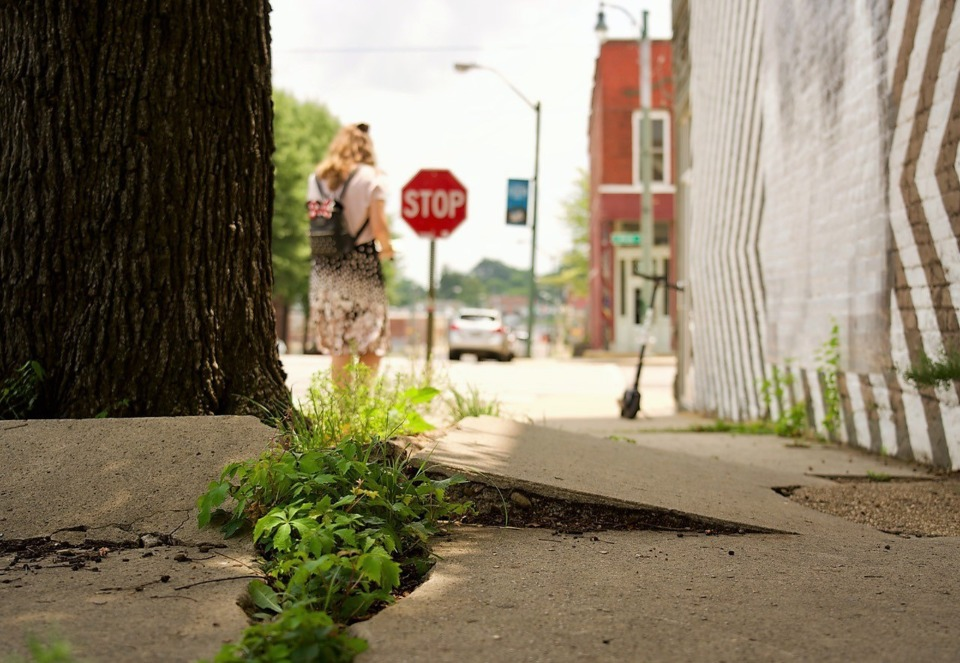 <strong>Damage caused by trees is just one of the reasons hundreds of miles of Memphis sidewalks such as this one on Vance Avenue near South Main need repair, according to city officials.</strong>&nbsp;(Tom Bailey/Daily Memphian)