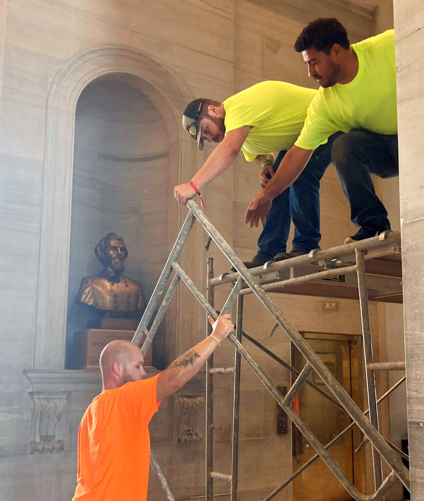<strong>Workers prepare scaffolding in front of a bust of Confederate general and early Ku Klux Klan leader Nathan Bedford Forrest at the State Capitol, Thursday, July 22, 2021, in Nashville. A decades-long effort to remove the bust from the Tennessee Capitol cleared its final hurdle Thursday, with state leaders approving the final vote needed to allow the statue to be relocated to a museum.</strong> (Kimberlee Kruesi/AP)