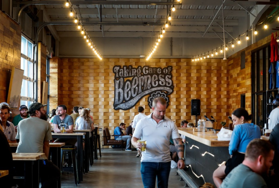 <strong>Grind City Brewing patrons enjoy the tasting room on Wednesday, July 21, 2021.</strong> (Mark Weber/The Daily Memphian)