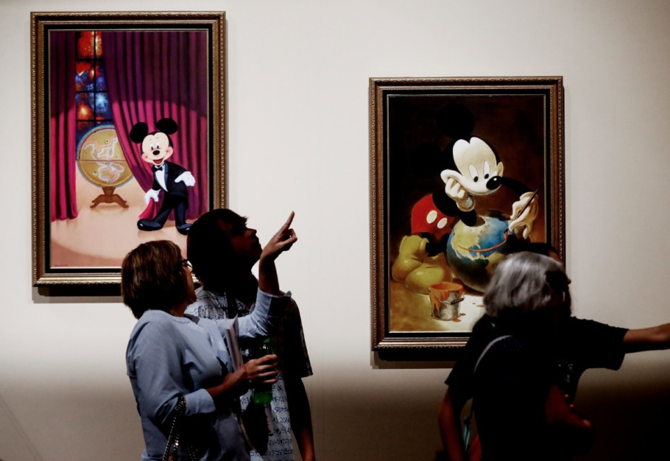 """<strong>Disney Fan Club members look over pieces during a tour of the """"Inside the Walt Disney Archives"""" exhibition on Thursday, July 22, 2021 at Graceland.</strong> (Mark Weber/The Daily Memphian)"""