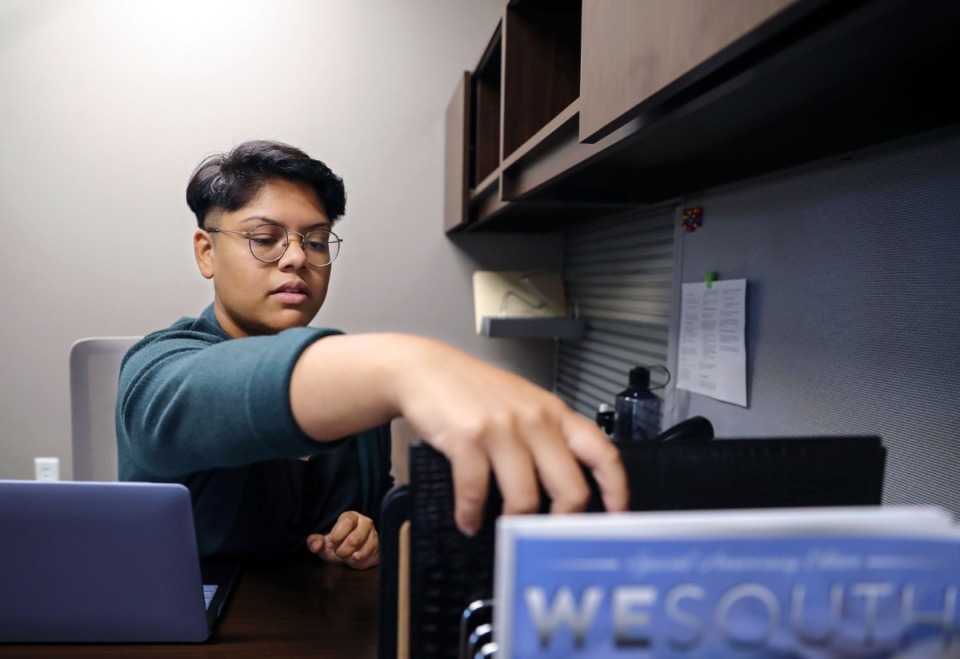 <strong>Women's Business Center South Program Manager Lamisa Hasan set up her new office in the Crosstown Concourse July 14, 2021.</strong> (Patrick Lantrip/Daily Memphian)