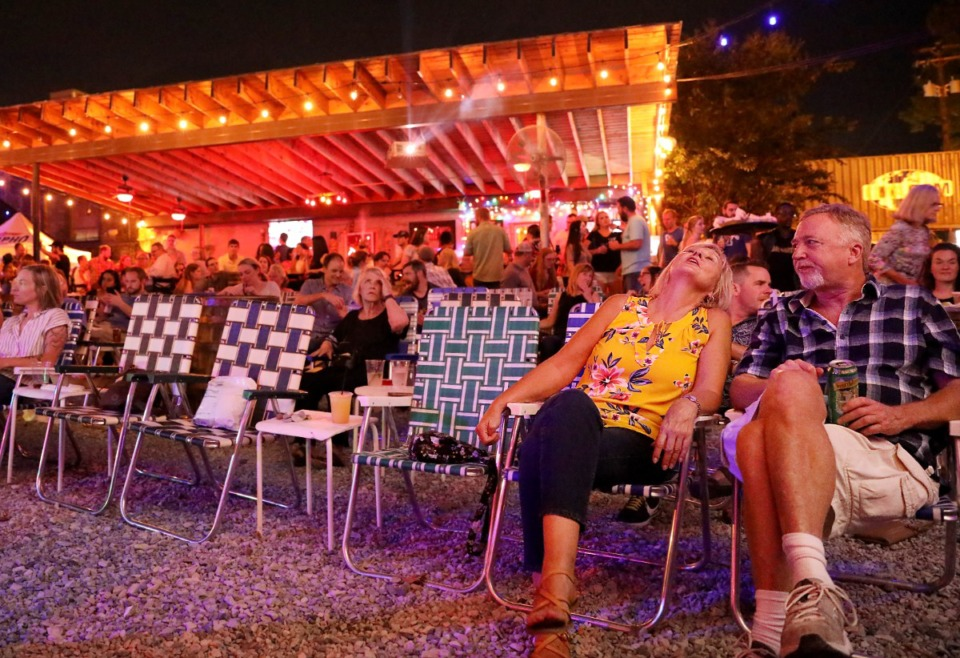 <strong>Judy McLaughlin and Michael Lakey sit both under the stars and in front of the stars at Railgarten in 2018. According to Lakeland&rsquo;s economic development specialist, a Downtown Memphis business owner who resides in Lakeland wants to bring a venue like Railgarten or Carolina Watershed to the suburb.&nbsp;</strong>(Patrick Lantrip/Daily Memphian file)
