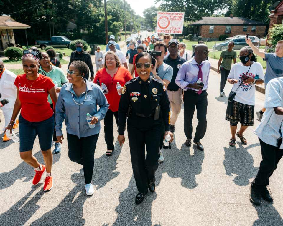 <strong>The new police chief, Cerelyn 'C.J.' Davis (center), walks through an Orange Mound street in District 4. Davis was introduced to neighbors and community leaders during a community walk to bring awareness to crime on Saturday, July 24, 2021.</strong> (Houston Cofield/Special To The Daily Memphian)