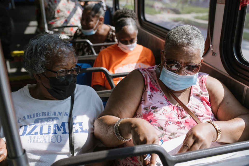 <strong>Neighbors chat during the bus ride to the Downtown Farmers Market, Saturday, July 24, 2021. </strong>(Lucy Garrett/Special to Daily Memphian)