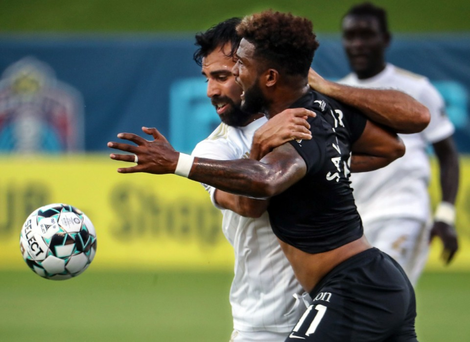 <strong>Memphis 901 FC forward Michael Salazar (11) fights off a defender during a July 24, 2021 match against FC Tulsa at AutoZone Park.</strong> (Patrick Lantrip/Daily Memphian)