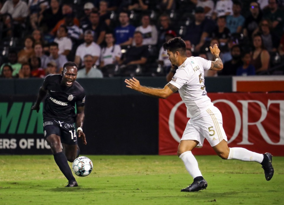 <strong>Memphis 901 FC forward Francis Atuahene (14) rushes to the ball during a July 24, 2021 match against FC Tulsa at AutoZone Park.</strong> (Patrick Lantrip/Daily Memphian)
