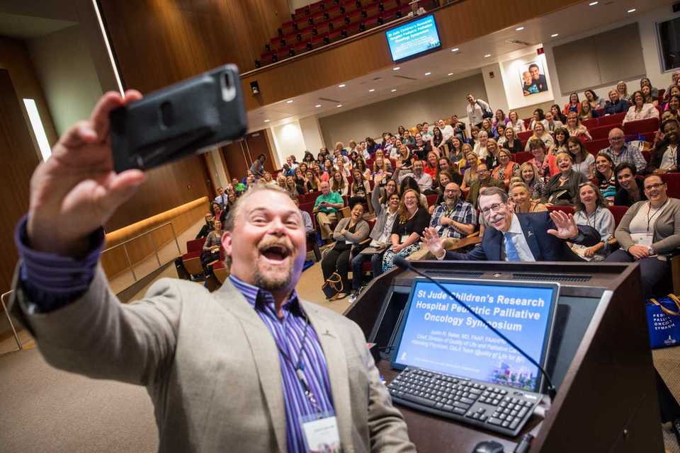 "<strong>Dr. Justin Baker, chief of St. Jude's Division of Quality of Life and Palliative Care, takes a selfie with Dr. James Downing, president and CEO of St. Jude, during last year's inaugural St. Jude Pediatric Palliative Oncology Symposium.</strong> <strong>""So often there's this tension that is felt around palliative care and hospice,"" said Baker. ""They think about it in the context of only bad news. We've tried to reshape that here.""</strong> (Photo courtesy of St. Jude Children's Research Hospital)"