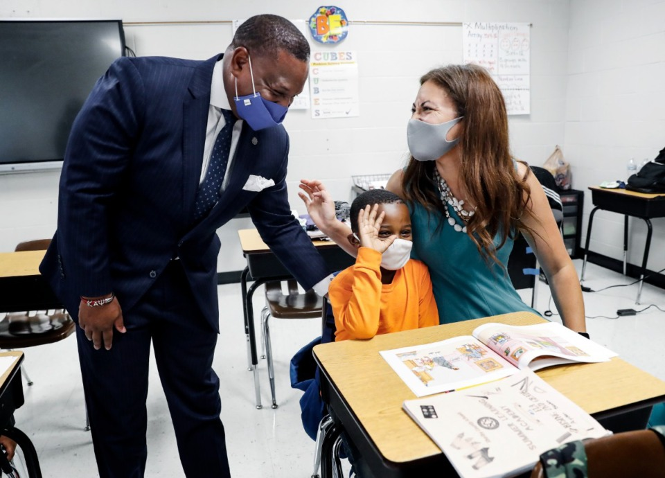 <strong>Joris M. Ray (left),&nbsp;Shelby County Schools superintendent, and Penny Schwinn (right), commissioner of the Tennessee Department of Education, talk with rising second grader Ayden Blades (middle) on Monday, July 26, 2021, during summer learning academy at Lowrance K-8.</strong> (Mark Weber/The Daily Memphian)