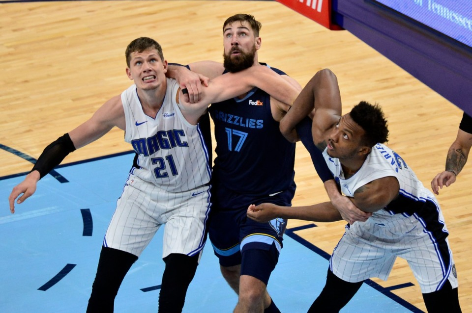 <strong>Grizzlies center Jonas Valanciunas (17) is a popular, important player on the team. But Grizz management is willing to trade, says Geoff Calkins, because it wants a championship.</strong> (Brandon Dill/AP file)
