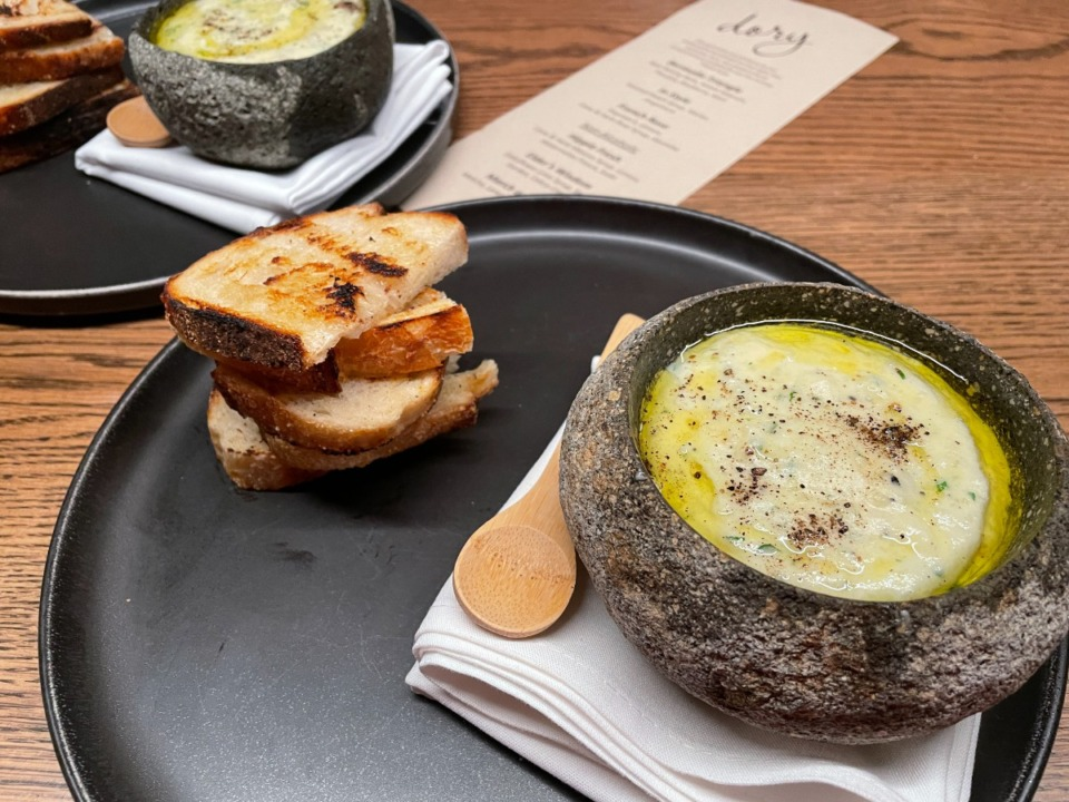 <strong>Brandade, a dish made of salt cod and potatoes, is served in a hollowed-out river rock at Dory.</strong> (Jennifer Biggs/The Daily Memphian)